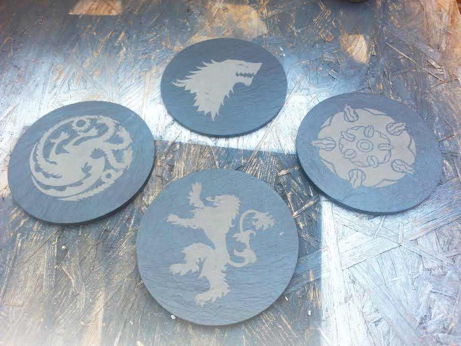Game of thrones slate coasters game of stone technabob - Slate drink coasters ...