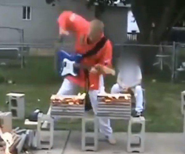 Karate Guy Plays Electric Guitar, Chops Flaming Boards