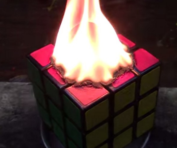Watch a Rubik's Cube Burn Thanks to a Red Hot Nickel Ball