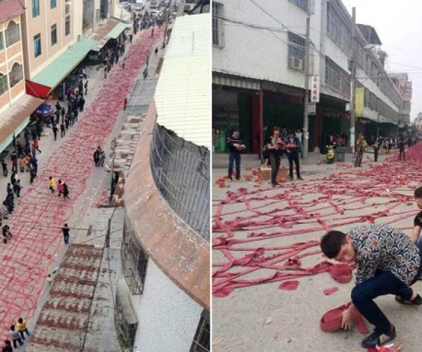 Chinese Street Filled with Firecrackers Lit in Chain Reaction