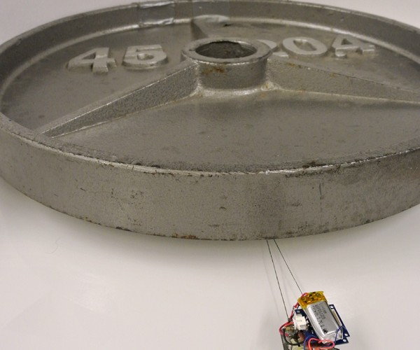 Tiny Robots with Sticky Feet Drag Heavy Loads: Atlas Tugged