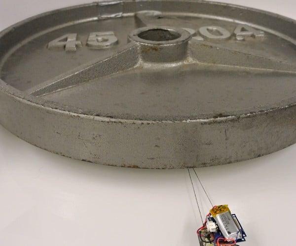 Tiny Robots with Sticky Feet Drag Heavy Loads: Atlas Tugged
