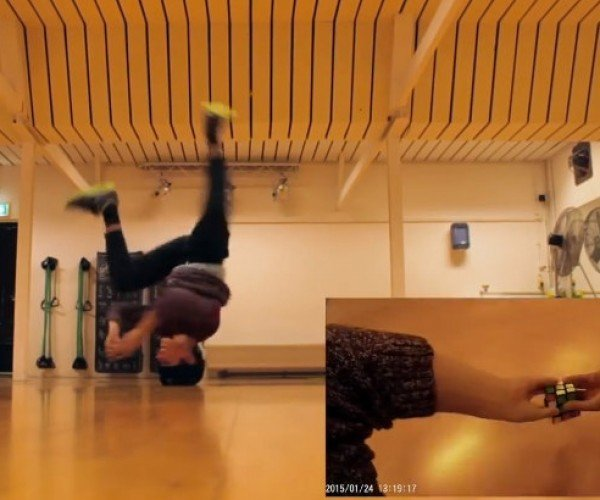 Kid Solves Rubik's Cube While on His Head, Spinning