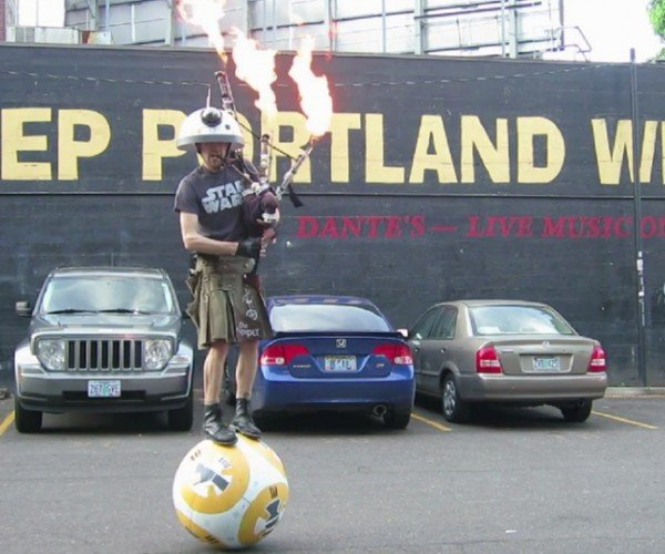 Guy Plays the Star Wars Theme with Flaming Bagpipes, Balances on BB-8 Droid