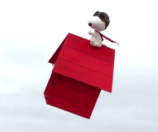 Snoopy Flying on His Doghouse
