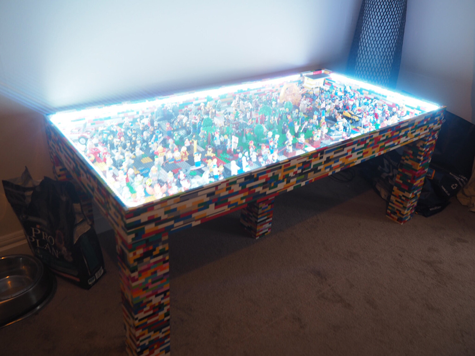 The Table Itself Is Made From Wood But Has Been Covered By Countless LEGO  Bricks. Beneath Its Glass Top Are More Than 250 Minifigures And Other LEGO  Pieces.