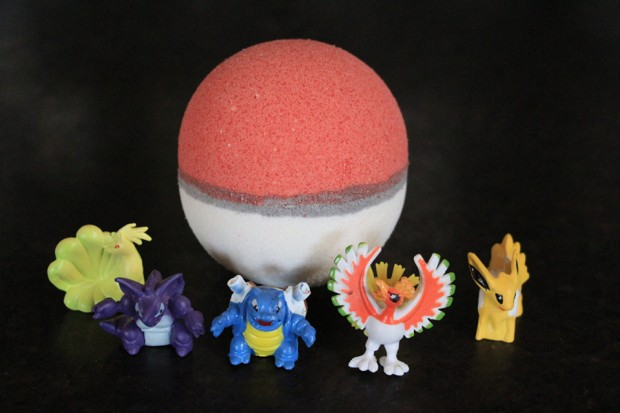 poke_ball_bath_bomb_with_toy_pokemon_by_fizzy_fairy_apothecary_1
