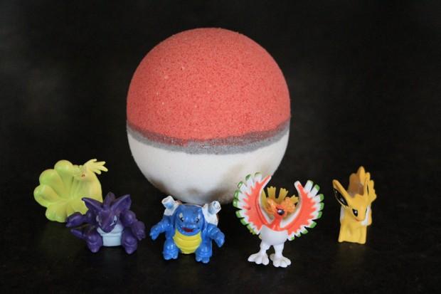 poke_ball_bath_bomb_with_toy_pokemon_by_fizzy_fairy_apothecary_1