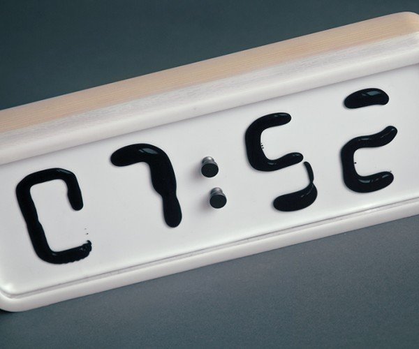Rhei Ferrofluid Clock: A Clock and Its Blob