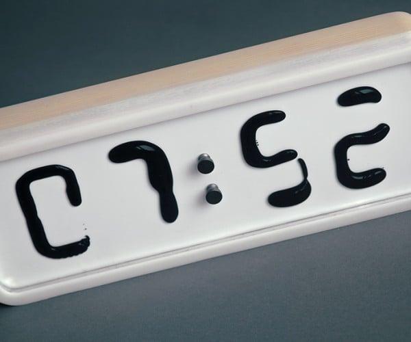 Rhei Ferrofluid Clock: A Clock and Its Blob