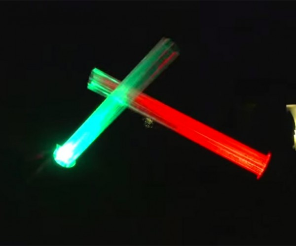 Guy Makes Giant Lightsabers for His Christmas Display
