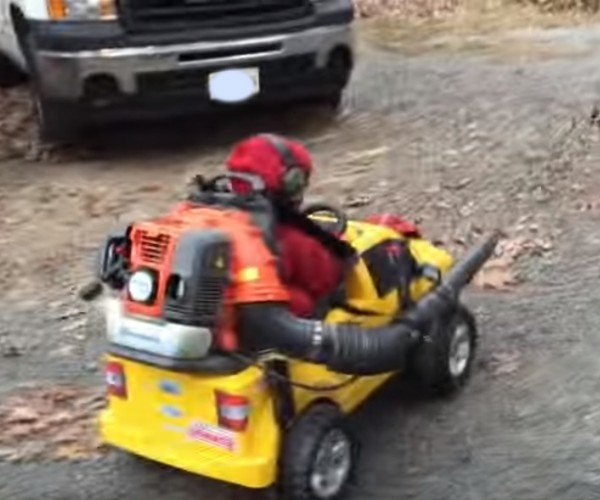 Guy Attaches Leaf Blower to Son's Power Wheels Truck, Lets Him Do the Work