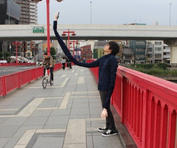 "Guy Doesn't Like Selfie Sticks, Invents ""Selfie Arms"""