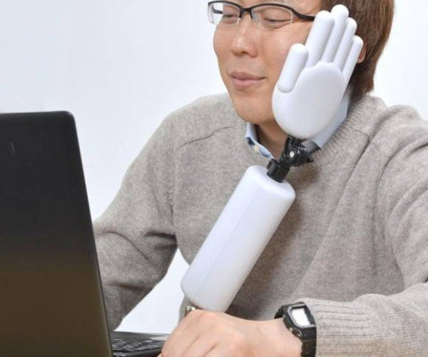 The Chin Rest Arm Will Help You Nap at Your Desk