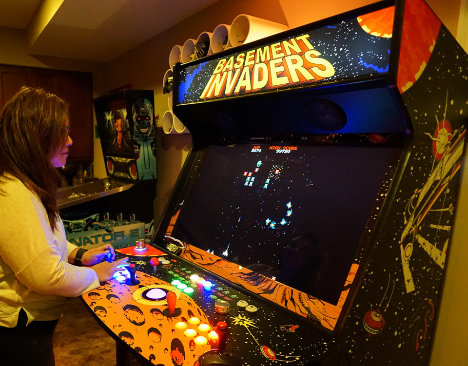 standing_at_arcade_hp_1