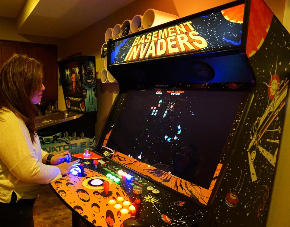 standing_at_arcade_hp_1