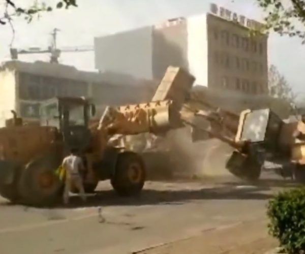 Chinese Construction Workers Have a Bulldozer Beatdown