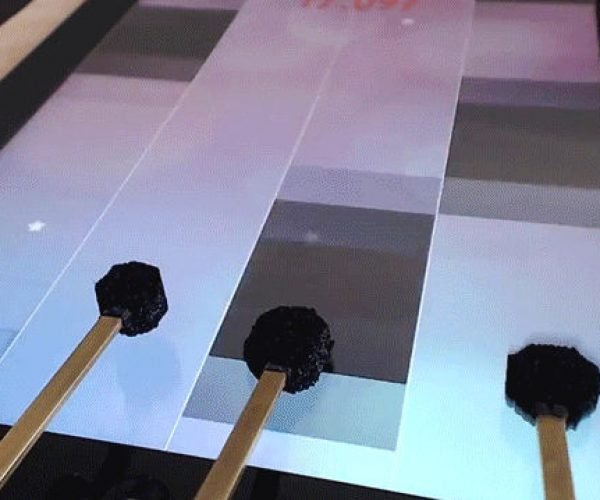 This DIY Robot Plays iPad Games Super Fast