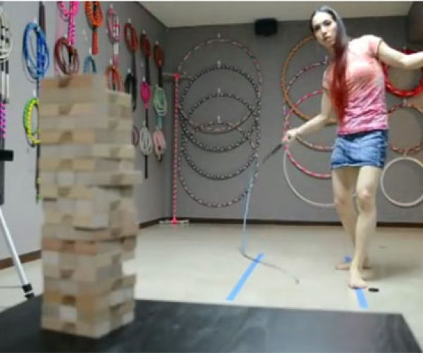 Girl Plays Jenga Using a Whip