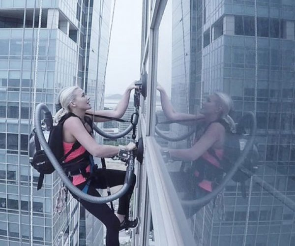 Rock Climber Scales Tall Building Using Vacuum Cleaners: Vacuu-Girl or Spider-Woman?