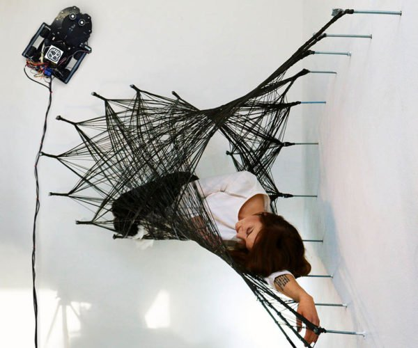 We're Doomed: Wall-climbing Robots Spin Giant Spiderwebs