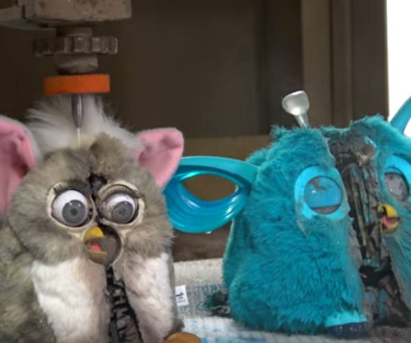 Watch Two Furbies Get Dissected by a Water Jet