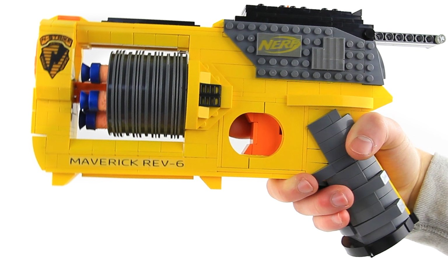 ... working replicas of guns in LEGO is something entirely different. Check  out this reproduction of the NERF Maverick REV-6 blaster by  AstonishingStudios.