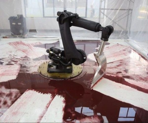 The Robot Arm of our Nightmares Plays in a Pool of Blood