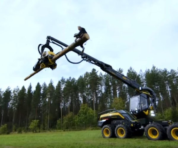 Guy Rides a Logging Machine Like a Rodeo Bull