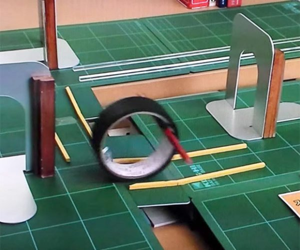 This Role of Tape Rolling Through an Obstacle Course Is So Cool