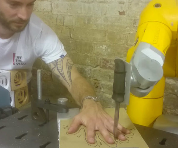 Guy Plays Five Finger Fillet with a Knife-Wielding Robot