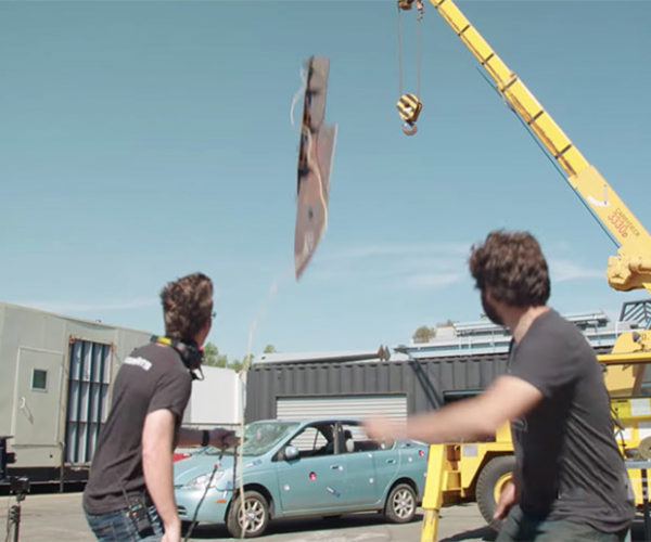 Watch a Giant Knife Stab an Old Toyota