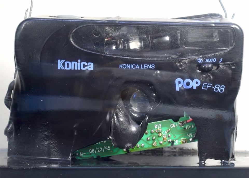 Watch a Camera Dissolve in Acetone Fumes