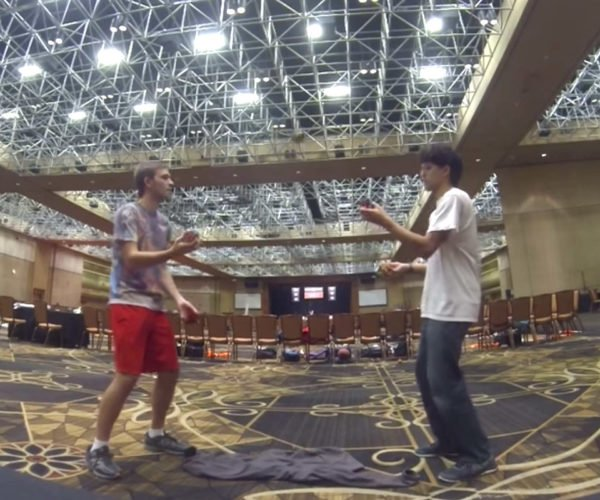 Two Guys Solve Five Rubik's Cubes While Juggling