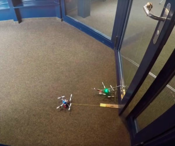 Micro Drones Work Together to Open a Door