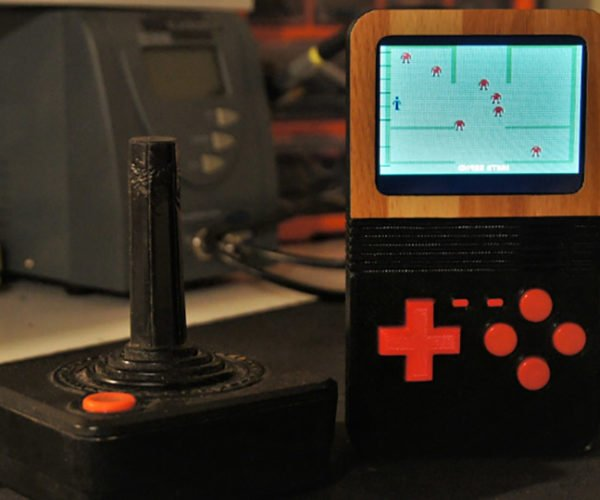 This Atari 2600 Handheld Brings The Woodgrain