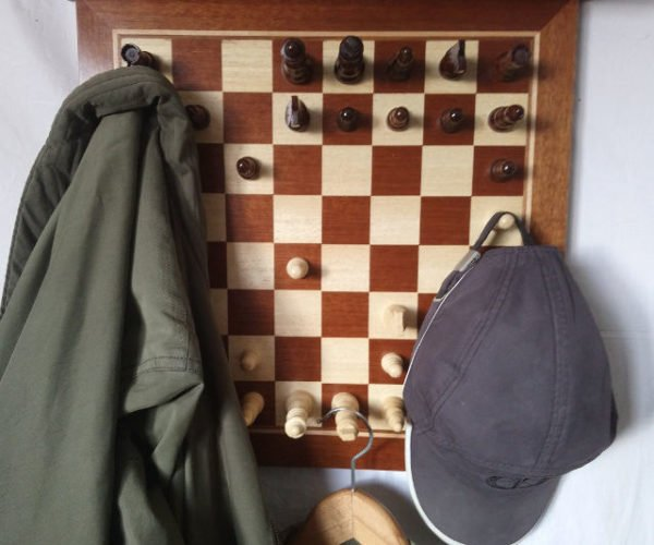 The Pieces on This Chess Set Coat Rack are Immovable