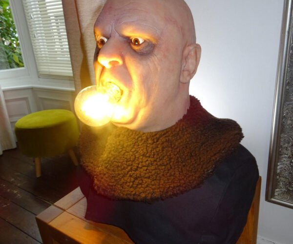 The Life-Size Uncle Fester With Lightbulb In Mouth Lamp of Your Dreams