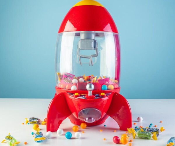 A Desktop Rocket Shaped Candy-Grabbing Claw Machine